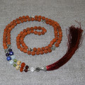 Rosary from rudraksha, decorated with semiprecious stones and silver