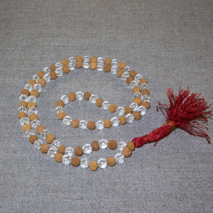 Rosary from white rudraksha and faceted crystal